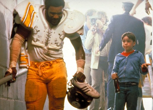 """Mean"" Joe Greene was one of Coca-Cola's biggest endorsement figures of the 1970s.  Here, in a ""Classic"" commercial, he shares a Coke with a fan after the Steelers win the Super Bowl. Source: jimmyrayeyouthfoundation.org"