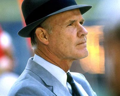 "Even more than their Silver Star, Tom Landry (with his fedora hat and gray suit) continues to be the most recognizable symbol of ""America's Team"" - the Dallas Cowboys.Source: coacheshotseat.com"
