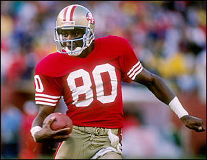 When Joe Montana added Jerry Rice to the high-powered 49ers offense in 1985, the result was a San Francisco Football Dynasty in the 1980s. Source: woodypaige.com