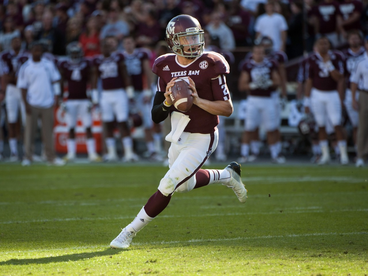 2012 Heisman Trophy Winner - Johnny Manziel has consistently been in the headlines, leading right up to College Football '13.  On Saturday, his Aggies will host Rice. Source: www.bloguin.com